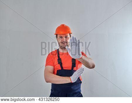 Pensive Repairman Making An Important Hand Gesturee