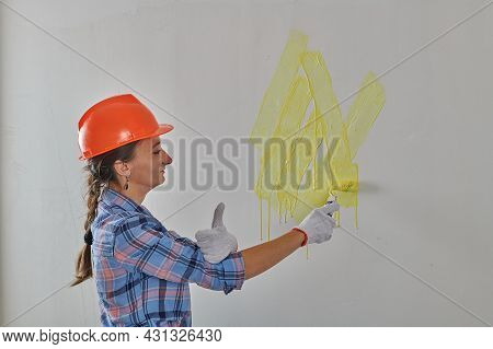 In A Helmet, A Foreman Paints The Wall In Bright Colors