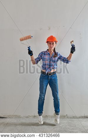 Girl In An Orange Helmet And Two Rollers