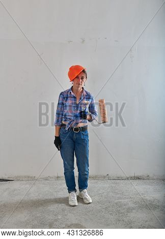Tired Painter In Orange Helmet And Roller