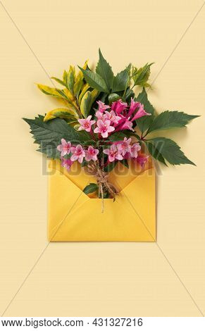 Greeting Card With Envelope And Pink Weigela Flowers For Mother's Day Or Birthday. Creative Design W