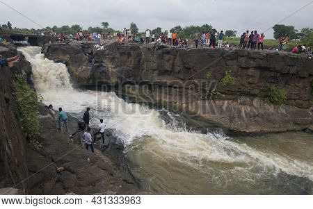 Weekend Crowd Gathered At The Someshwar Waterfall In The Evening. Location : Nashik, Maharashtra, In