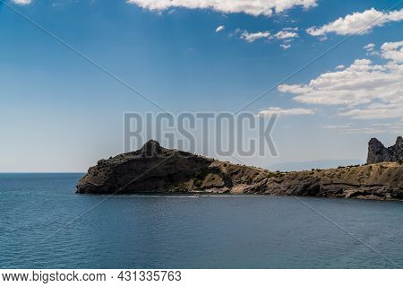 The Republic Of Crimea. July 15, 2021. View Of Cape Kapchik, A Silhouette Resembling A Dolphin In Th