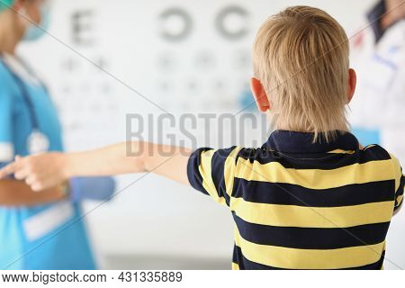 Little Boy Stands In The Ophthalmologists Office