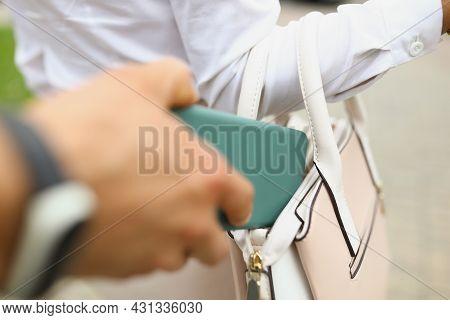 A Man Steals A Wallet From A Womans Bag Close Up