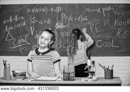Using Modern Technologies. Little Girls Scientist Work With Microscope. Biology Science. Happy Littl