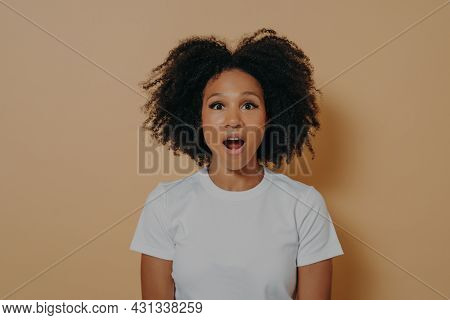 Photo Of Amazed Stunned Dark Skinned Female Looking At Camera With Opened Mouth, Shocked African Wom