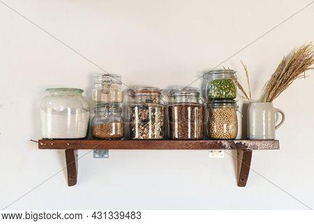 Ingredients in jars on a wooden shelf