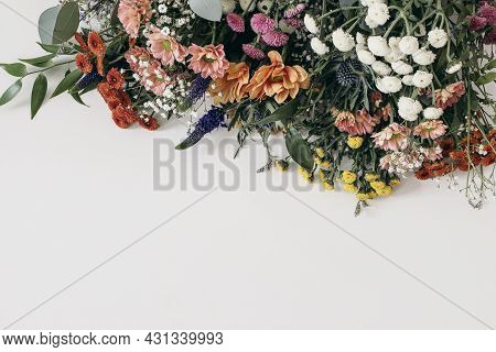 Decorative Floral Frame, Banner. Closeup Of Gypsophila And Colorful Santini Mums Flowers With Eucaly
