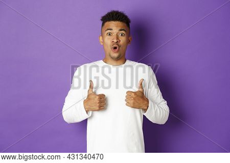 Impressed Handsome African-american Guy, Showing Thumbs-up In Approval, Praise Great Promo, Like And