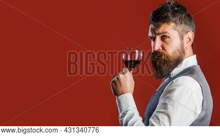 Sommelier With Red Wine. Bearded Man With Wineglass. Restaurant. Degustation. Male With Alcohol. Cop