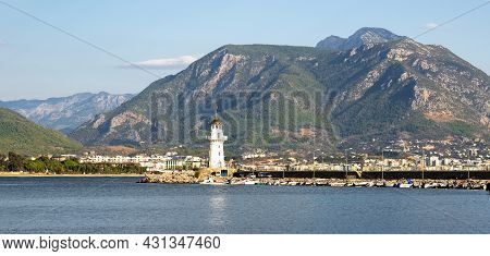 Turkey, Alanya - November 9, 2020: The Old Lighthouse In The Port Of Alanya Against The Backdrop Of