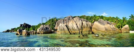 Panoramic view of a beautiful beach Anse Source d'Argent with big granite rocks in sunny day. La Digue Island, Indian ocean, Seychelles. Tropical landscape.