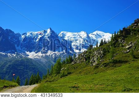 Idyllic landscape with Mont Blanc mountain range in sunny day. Nature Reserve Aiguilles Rouges, Graian Alps, France, Europe.