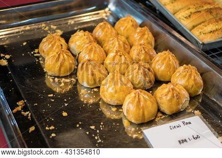 Seremban Siew Pau Is One Of The Famous Malaysian Food.it Is A Type Of Baked Bun With Flaky Pastry Bu