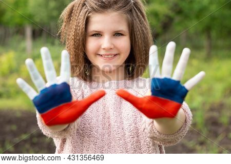 Child Girl Show Hands Painted In Russia Flag Colors Walking Outdoor. Day Of Russian Flag. Patriots P