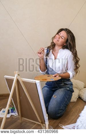 Creative Painter In Working Process. Artist Workplace, Hobby, Craft Tools. Artist Female Canvas Pain