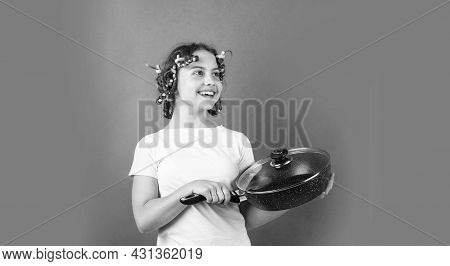 Funny Little Housewife With Pan. Cute Funny Little Girl Wearing The Curler And With The Pan. Small G