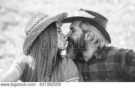 True Feelings. Enjoying Life. Love And Harmony. Bearded Cowboy In Hat Kissing Adorable Girlfriend. C