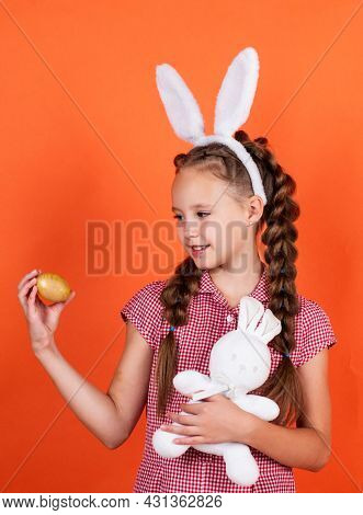 Happy Teen Girl In Bunny Ears Hold Rabbit Toy And Egg, Happy Easter