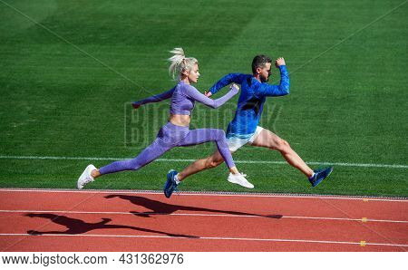 Sport Couple Run Fast To Win. Fitness Sprinters. Athletic Man And Sexy Woman Compete In Sprint