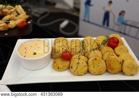 Yellow Cutlets With Sauce. Catering, Food On Buffet Table On White Plate In A Street. High Quality P