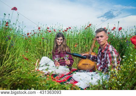 Love And Romance. Opium. Spring Countryside. Lovers With Guitar In Flower Field. Music.