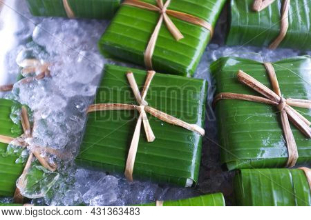 Traditional Thai Style Packaging , Homemade Tofu  Wrapped In Banana Leaf With Natural String