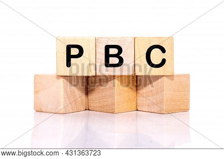Concept Image Of Business Acronym Pbc As Performance Based Contract Written On Wooden Cubes On A Whi