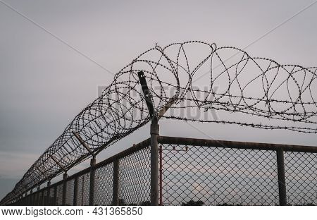 Prison Security Fence. Barbed Wire Security Fence. Razor Wire Jail Fence. Barrier Border. Boundary S