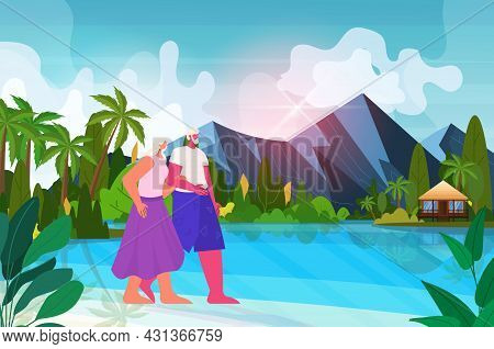 Senior Man Woman Walking On Tropical Beach Aged Couple Having Summer Vacation Active Old Age Concept