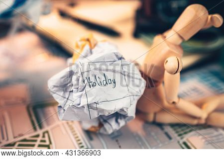Crump Paper Calendar With The Word Holiday Written On. Cancel And Fail Plan Travel, Holiday, Vocatio