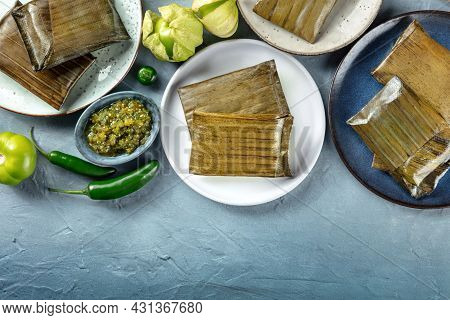 Tamale, Traditional Dish Of The Cuisine Of Mexico, Various Stuffings Wrapped In Green Leaves, Top Sh