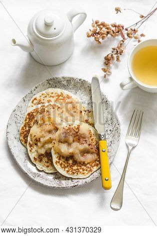 Oatmeal Mini Crepes Without Flour With Apple Cinnamon Sauce And Green Tea On A Light Background, Top