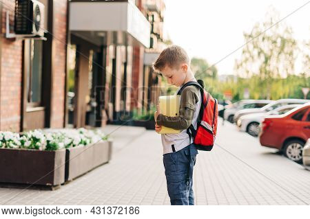 Back To School. Cute Child With Backpack Holding Notepad And Training Books Going To School. Boy Pup