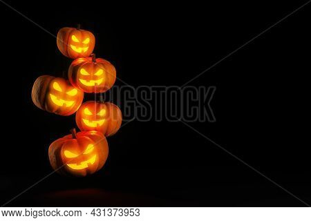 Flying Halloween Pumpkin Heads With Glowing Faces On Dark, 3d Rendering, Copy Space. Holiday Backgro