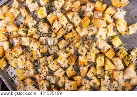 Ciabatta Cubes Prepared For Baking With Rosemary And Olive Oil On A Baking Sheet - Making Croutons