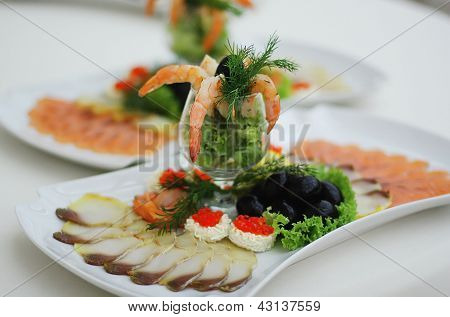 Different foods: vegetable, caviar