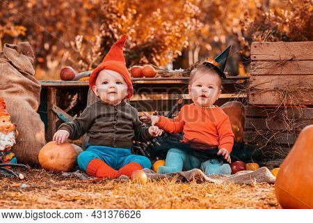 Halloween And Autumn Holidays. A Boy In A Dwarf Costume And A Girl In A Witch Costume. Outdoor. Clos
