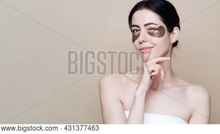 Eye Patch, Beautiful Woman With Natural Skin And Green Hydro Gel Eye Patches Under Her Eyes. Caucasi