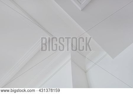 Detail Of Corner Ceiling And Walls With Intricate Crown Moulding. Interior Construction And Renovati
