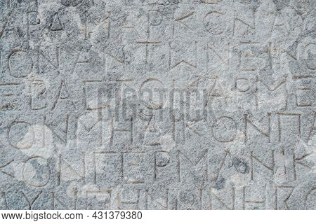 Antique Greek Inscriptions Carved On The Stone Of The Old Ruins Of An Antique Greek City