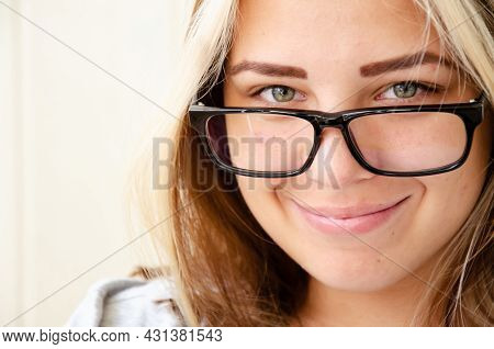 Brunette Young Woman With Glasses. Concept Of Choosing Profession. Beautiful Caucasian Young Girl Wi
