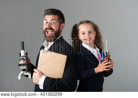 Amazed Teacher With Excited Happy Pupil School Girl. Portrait Of Funny School Girl And Tutor With Sc