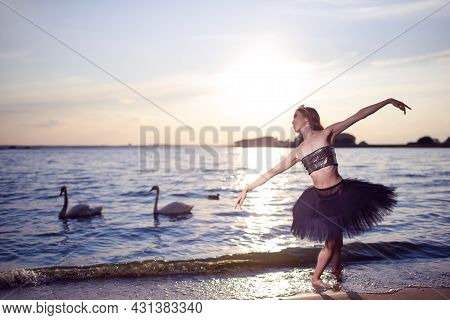 Vulnerable And Sensual Japanese Ballet Dancer In Black Tutu And Silver Crown Posing Near Seashore Du