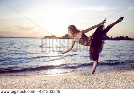 Professional Sensual Japanese Ballet Dancer In Black Tutu And Silver Crown Posing Near Seashore Duri