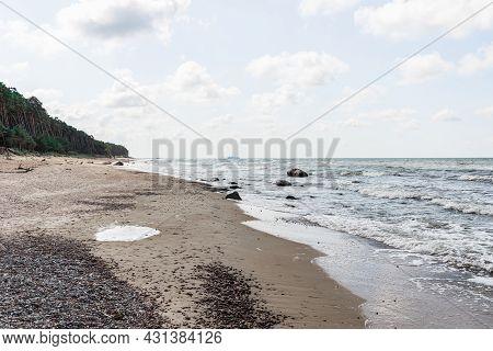 Empty Beautiful Sandy Stony Rocky Beach On Overcast Day.blue Sky,white Clouds,summer Day.