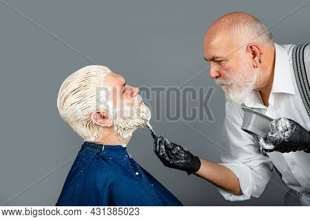 Coloring Moustache. Hairdresser Making Of A Color Hair For A Bearded Hipster Guy. Process Of A Man H