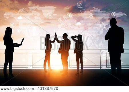 Businesspeople With Hi-five Gesture Standing On Sunset Background With Glowing Map Interface. Succes