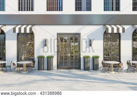 Creative Concrete Cafe Exterior With Terrace Furniture In Daylight. 3d Rendering